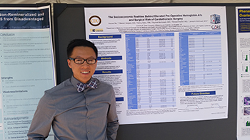Another student displays his research