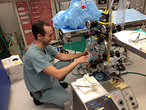 A lab member operates medical machinery
